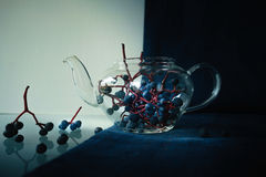 Still life. bunches of wild grapes in a glass pot. close-up. Royalty Free Stock Photos