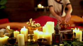 Still life with burning candles and massage herbs. 4k stock footage