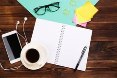 Still life, business, office supplies or education concept : Top view of working desk with blank notebook with pencil, coffee cup stock photo