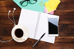 Still life, business, office supplies or education concept : Top view of working desk with blank notebook with pencil, coffee cup stock photography