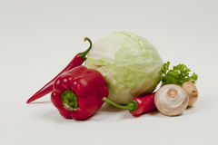 Still life with cabbage. Still Life with peppers, cabbage and mushrooms Royalty Free Stock Photography