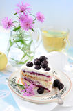 Still life with cake and cornflowers Stock Image