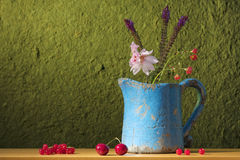 Still life with a can, flowers and fruit Royalty Free Stock Photo