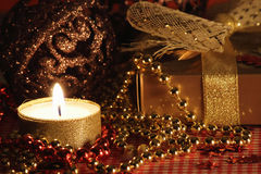 Still life with the candle and the gift. royalty free stock photography