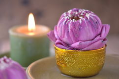 Still life of candle and lotus Stock Photo