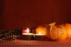 Still life with the candle and mandarines. Royalty Free Stock Image