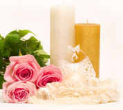 Still-life with candle and pink roses Stock Photo