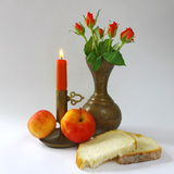 Still life with candle and roses Stock Photo
