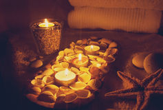 Still life candles and seashells. Still life with candles, seashells and stones Royalty Free Stock Photo