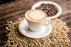 Still life of cappuccino cup and coffee beans Stock Image