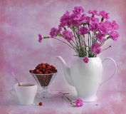 Still life with carnations and strawberry Stock Photography