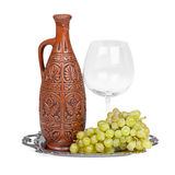 Still life of ceramic bottle, grapes and glass Stock Photography
