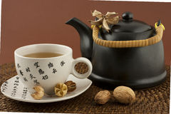 Oriental teapot and mugs Stock Photo