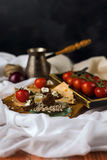 Still life. Cezve, cherry tomato branch, bread, fork Royalty Free Stock Photo