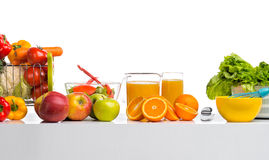 Still life cfreshly squeezed juice, fruit and vegetables on tabl Stock Photography