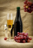 Still life with champagne bottle and fruits Royalty Free Stock Images