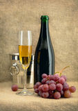 Still-life with champagne wine and grapes Stock Photography