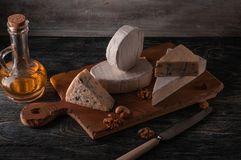 Still life with cheese. stock photo