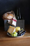 Still life with cheese,grapes and bread Stock Photography