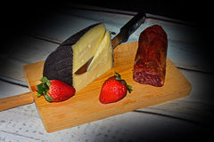 Still life with cheese, loin and strawberries Royalty Free Stock Photos