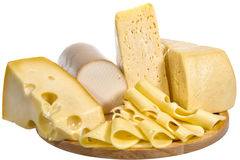 Still Life with Cheese. Mild and delicate flavor cheese. Variety of semi-soft cheeses with smooth texture Stock Photos