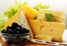 Still life with cheese and olives. Still life of different types of cheese with olives royalty free stock photo
