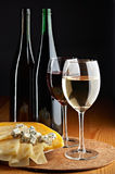 Still life with cheese, red and white wines royalty free stock photography