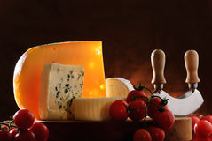 Still-life with cheese and tomatoes Stock Images