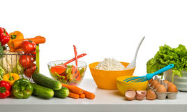Still life of cheese , vegetables and eggs on table Royalty Free Stock Photo