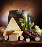 Still life with cheese and wine Stock Photos