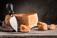 Still life of cheese. On a wooden board Stock Image