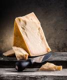 Still life of cheese. On a wooden board Royalty Free Stock Images