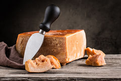 Still life of cheese. On a wooden board Royalty Free Stock Photos