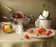 Still life with cherries and apples Royalty Free Stock Images