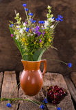 Still life with cherries and fresh flowers Royalty Free Stock Images