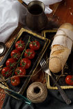 Still life. cherry tomato branch, bread, fork Royalty Free Stock Photography