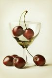 Still-life with cherry and wineglass Royalty Free Stock Image