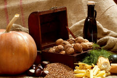 Still Life with Chest, Nuts, Pumpkin, Bread Royalty Free Stock Photography