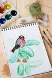 Still life with childish watercolor painting of bullfinch Stock Photography