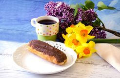 still life with choclate eclair and flowers for mom Royalty Free Stock Image