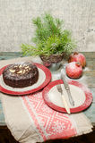 Still life with chocolate cake, Christmas tree and pomegranate Royalty Free Stock Image