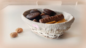 Still life with chocolate chip cookies. White basket with chocolate biscuits on white table Royalty Free Stock Photos