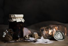 Still life with christmas baking ingredients - nuts, sugar cryst. Als, cookie molds on wooden board - photo with selective focus royalty free stock photos