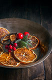 Still life of Christmas bronze plate with orange slices. Christmas Background. Royalty Free Stock Photos