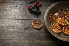 Still life of Christmas bronze plate with orange slices. Christmas Background. Stock Photos