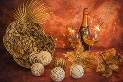 Still life with Christmas decoration, champagne and sparklers royalty free stock photo