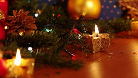 Still Life with Christmas Decorations and Burning Candles stock video footage