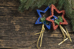 Still life of christmas ornament and tree branch on wooden board Royalty Free Stock Photography