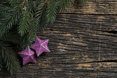 Still life of christmas ornament and tree branch on wooden board Stock Photography