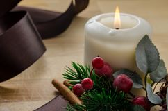 Candle and berries for a special Christmas Stock Photos